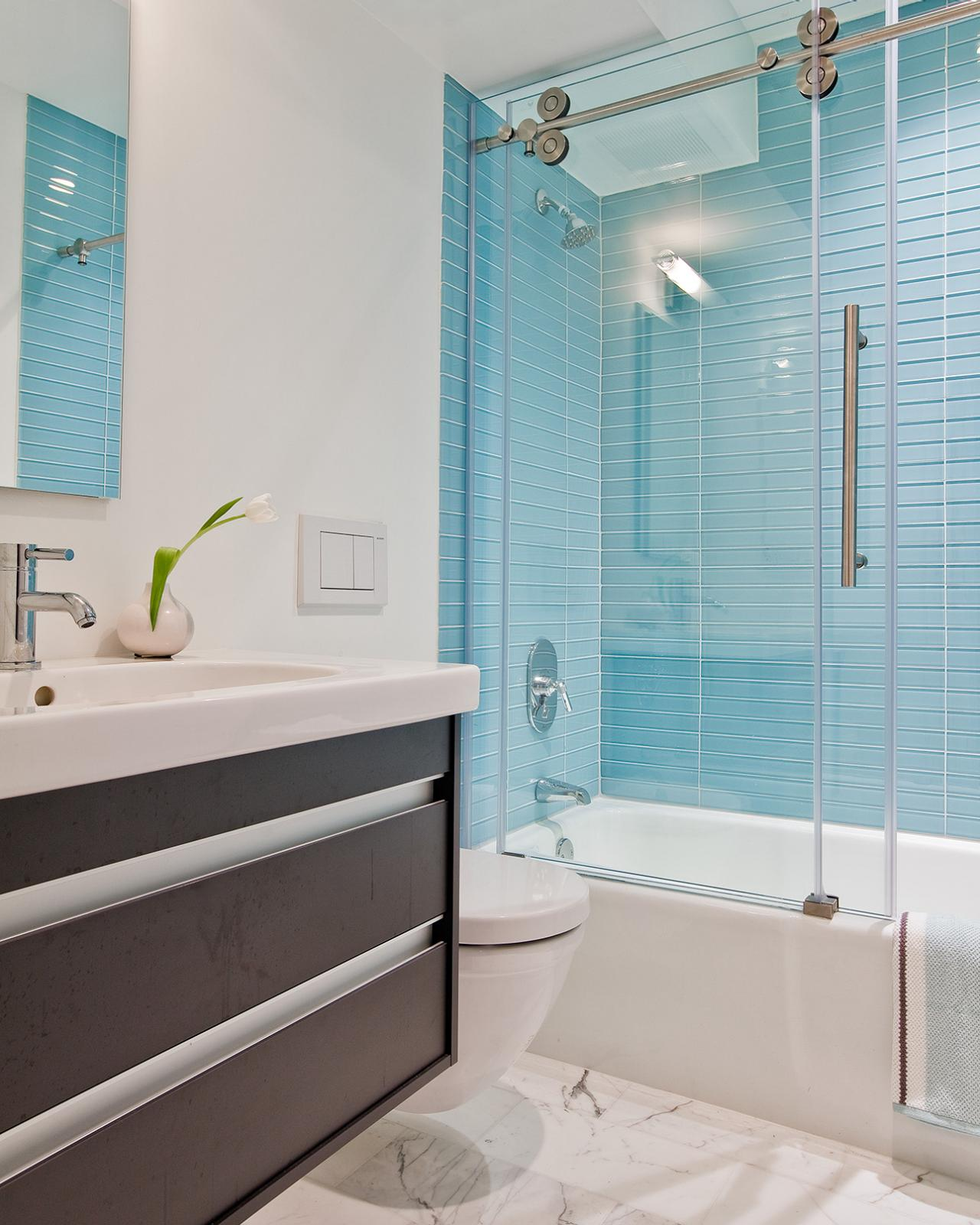 A bathroom with a sink and a shower Description generated with very high confidence